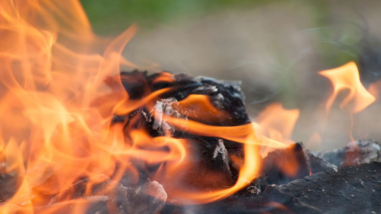 A fire chars an unknown item in a file photo.