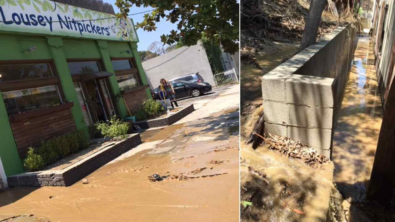 A local business (left) is seen with water damage after a water main break gushed thousands of gallons in the Hollywood Hills area on Sunday, July 31, 2016.