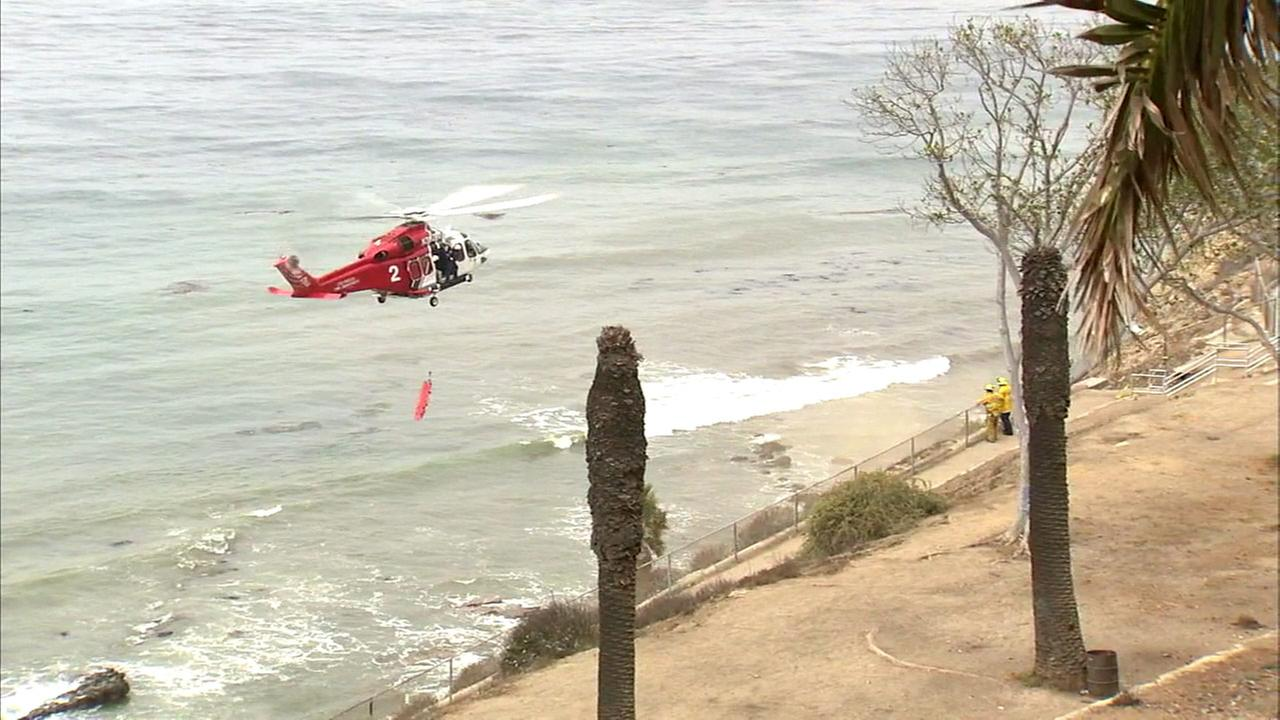 The bodies of a man and a woman were found at the base of a cliff in San Pedro on Sunday, Aug. 7, 2016, according to police.
