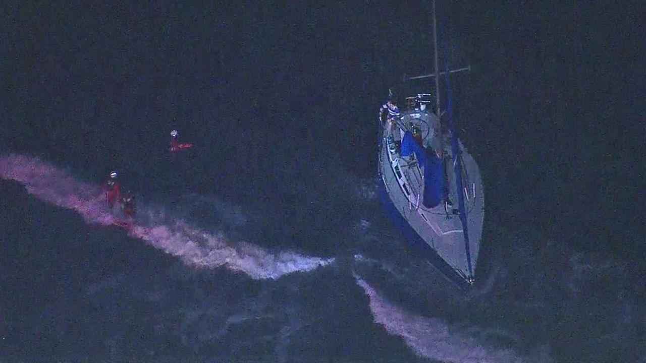 Los Angeles County lifeguards work to rescue people trapped on a boat that ran aground in Marina del Rey on Tuesday, Aug. 9, 2016.