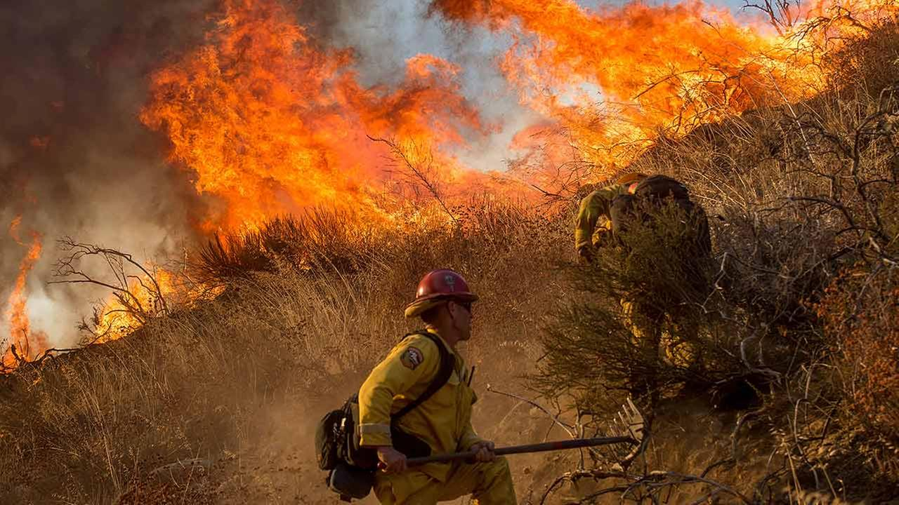 Firefighters battle a wildfire on Cajon Boulevard in Keenbrook, Calif., on Wednesday, Aug. 17, 2016.Noah Berger