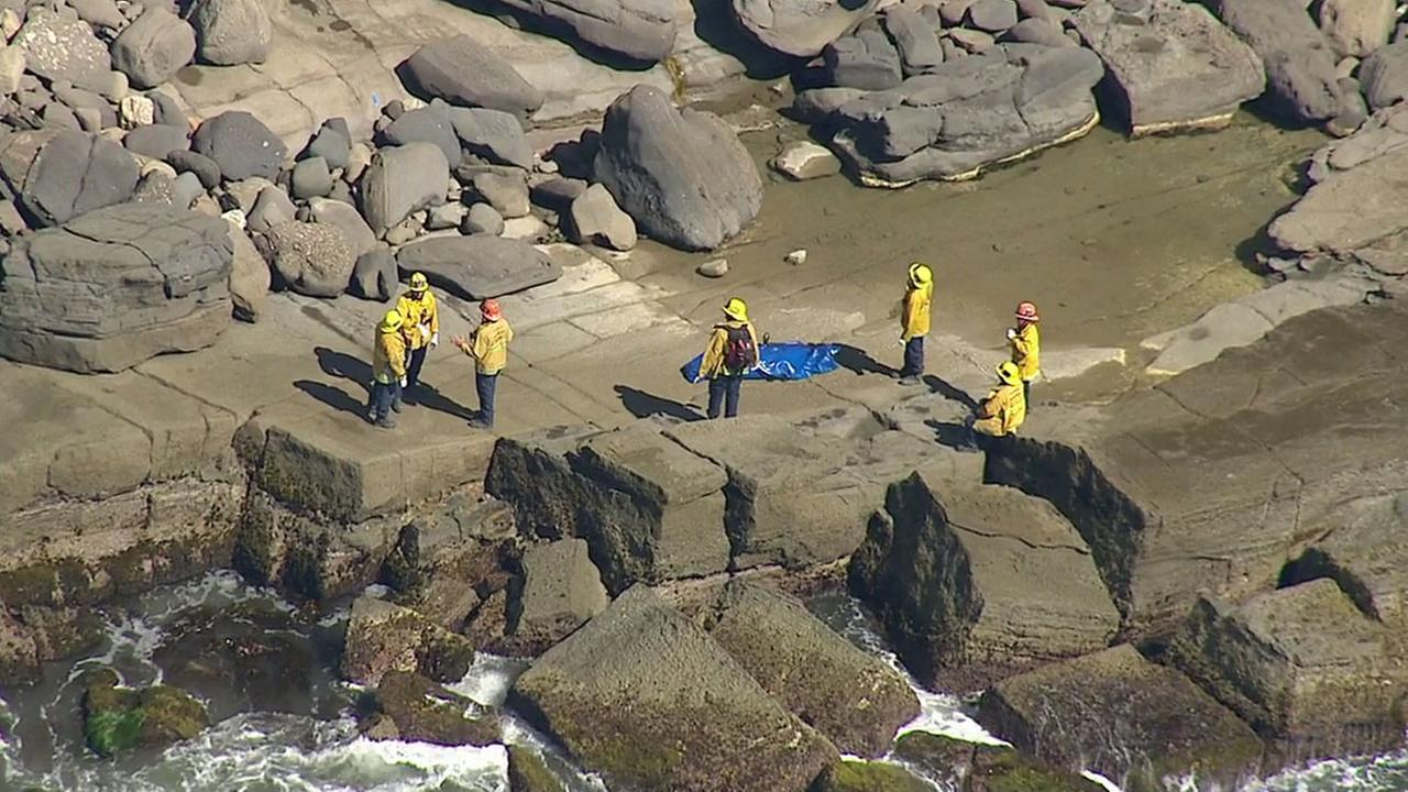 Authorities removed the body of a woman at the bottom of a cliff in San Pedro after a tragic accident on Friday, Aug. 19, 2016.