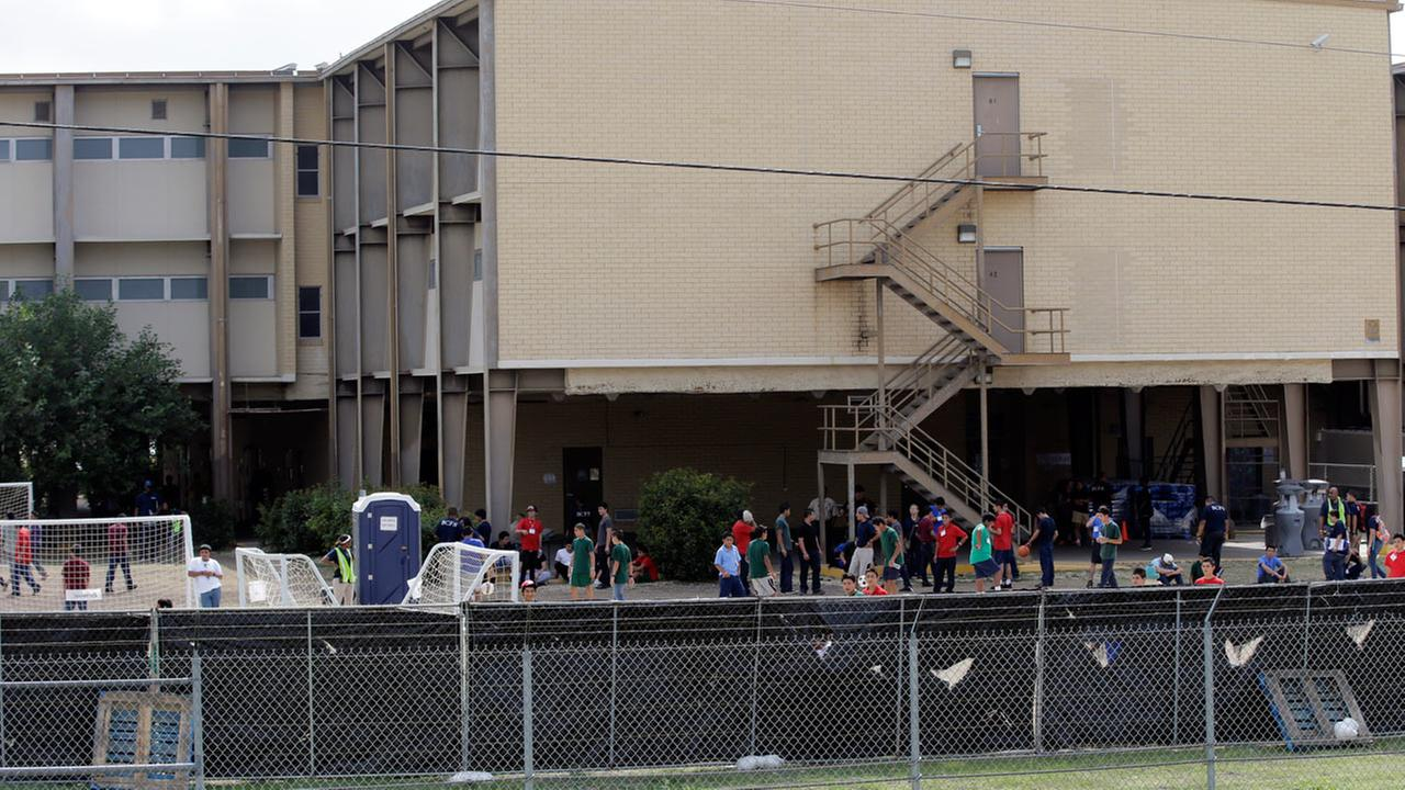 A temporary shelter for unaccompanied minors who have entered the country illegally is seen at Lackland Air Force Base, Monday, June 23, 2014, in San Antonio.