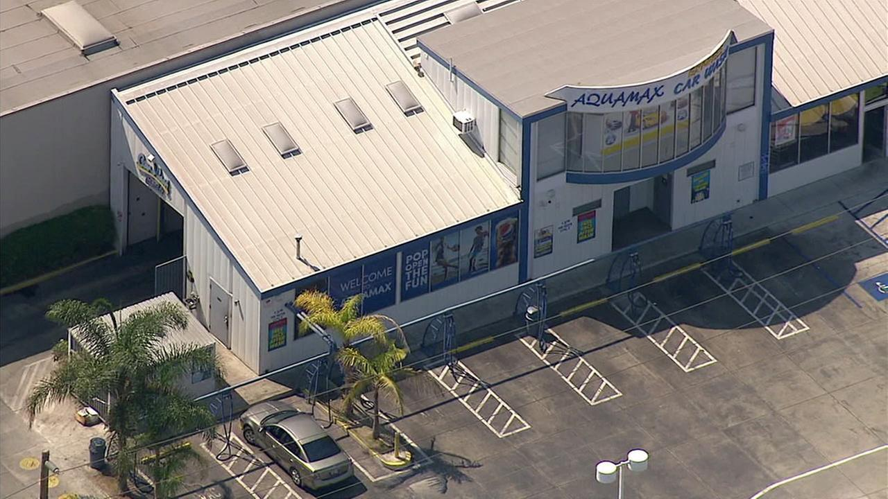 A man armed with an ax barricaded himself inside Aquamax Carwash in Carson on Tuesday, Aug. 23, 2016, according to the Los Angeles County Sheriffs Department.