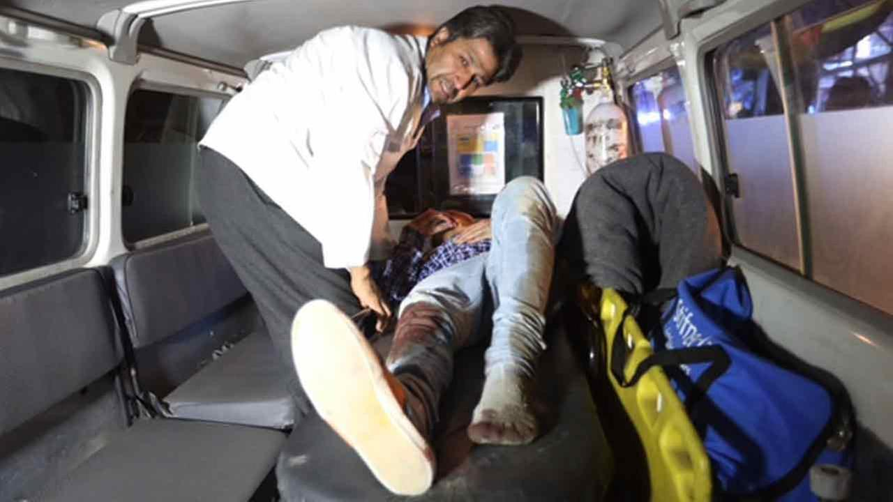 A wounded person is treated in an ambulance after a complex Taliban attack on the campus of the American University in the Afghan capital Kabul on Wednesday, Aug. 24, 2016.