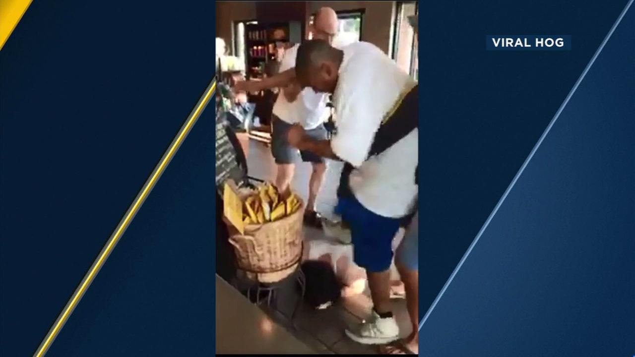 Video shows a man in  his underwear being beaten by a neighbor at a Starbucks in Vancouver, Washington.