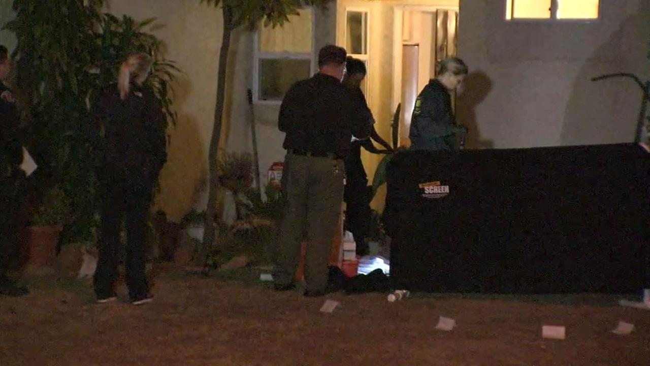 Authorities investigated the shooting death of a woman on Thursday, Aug. 25, 2016. She was found on the front lawn of a Garden Grove home the night before.
