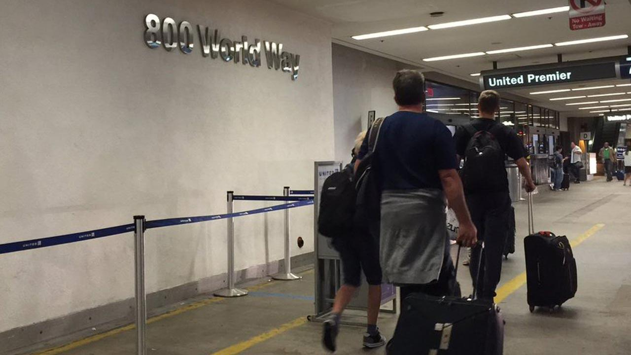 Travelers are seen at Los Angeles International Airport on Monday, Aug. 29, 2016, the day after a false report of an active shooter caused widespread panic at the facility.