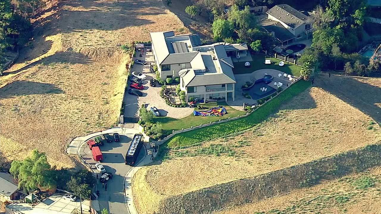 The LAPD said a woman called requesting help near the home of Chris Brown in Tarzana on Tuesday, Aug. 30, 2016.