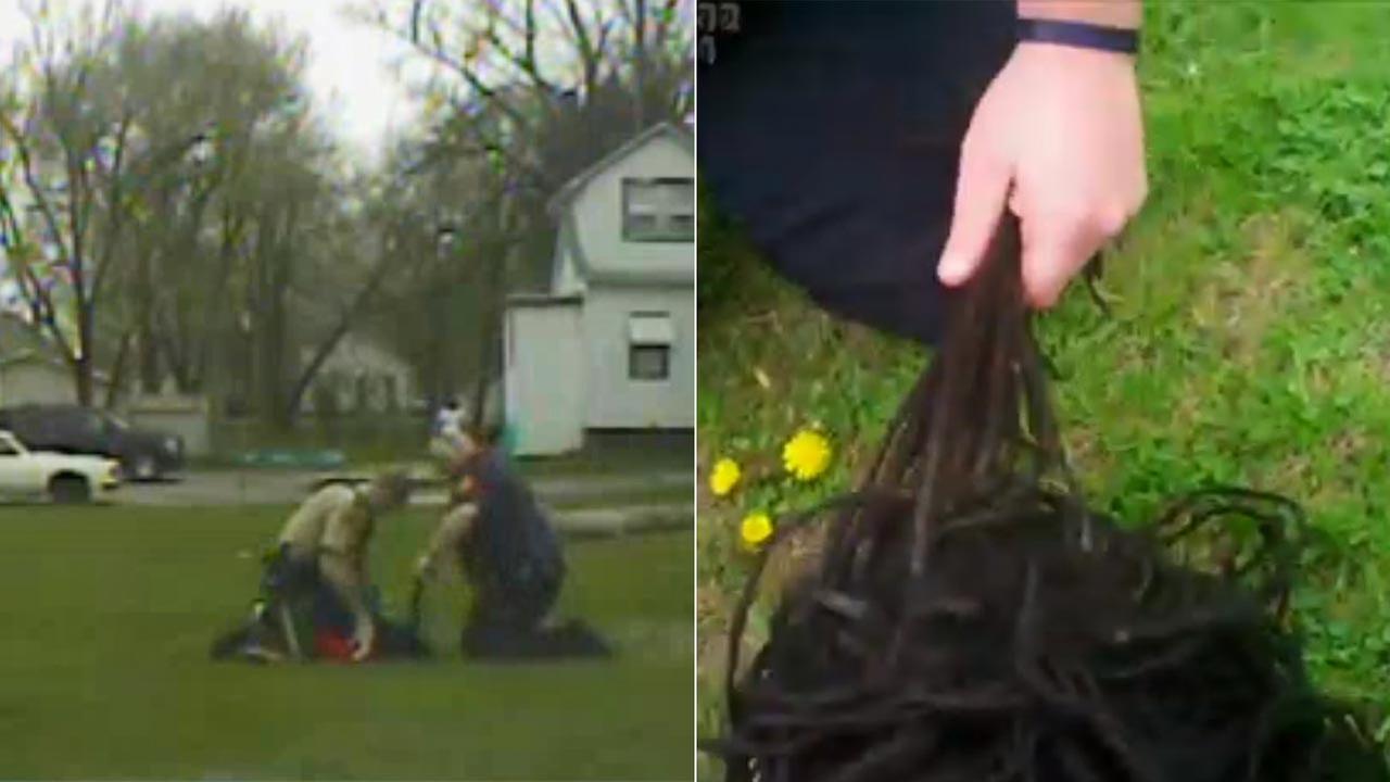 Waterloo officer Adam Wittmayer is seen yanking on handcuffed Montavis Kellers dreadlocks in frames from an April 19, 2016 video provided by Black Hawk County Sheriffs Office.