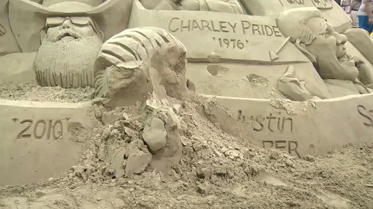 A sand sculpture featuring Justin Biebers face was smashed after a vandal threw themselves on it at the New York State Fair.
