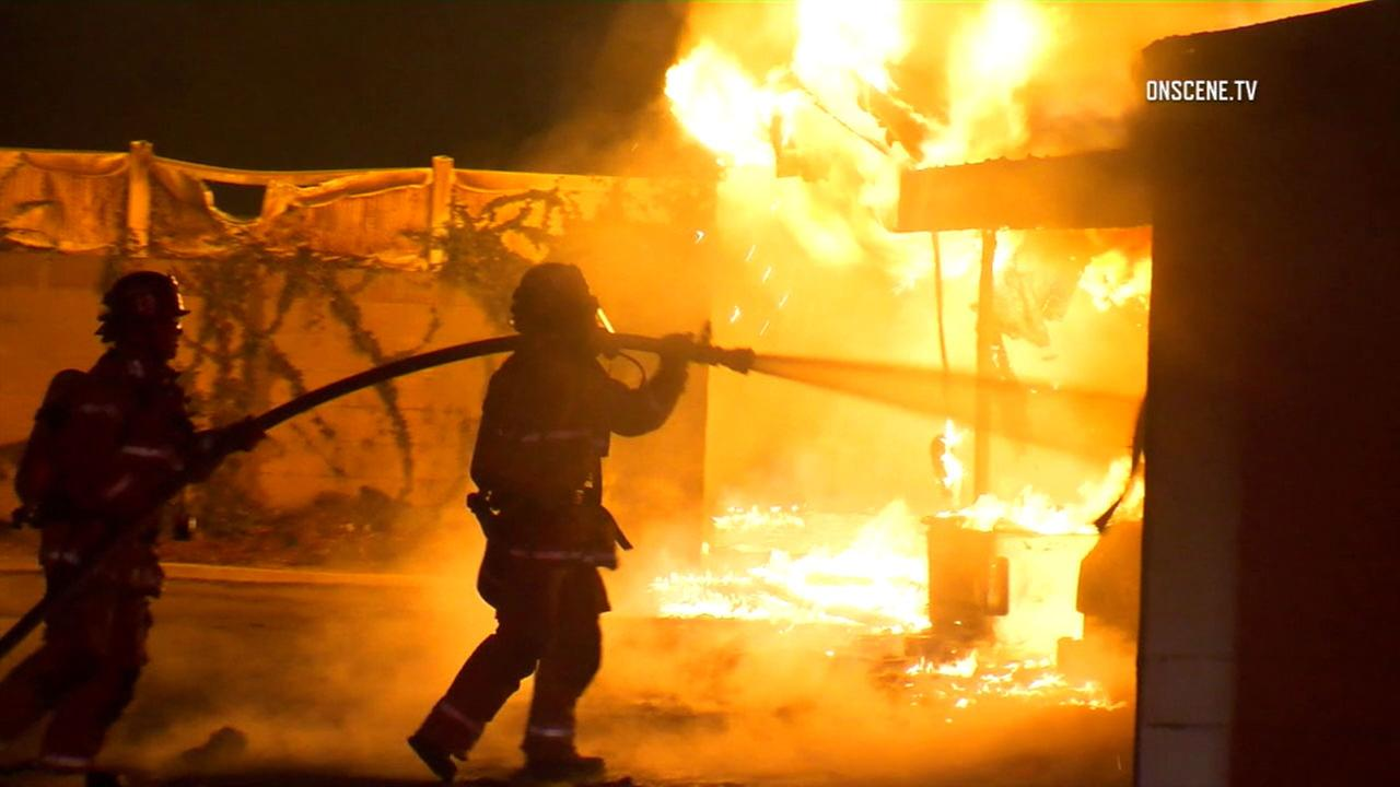 Firefighters battle an inferno that erupted in a carport in Anaheim on Tuesday, Sept. 6, 2016.