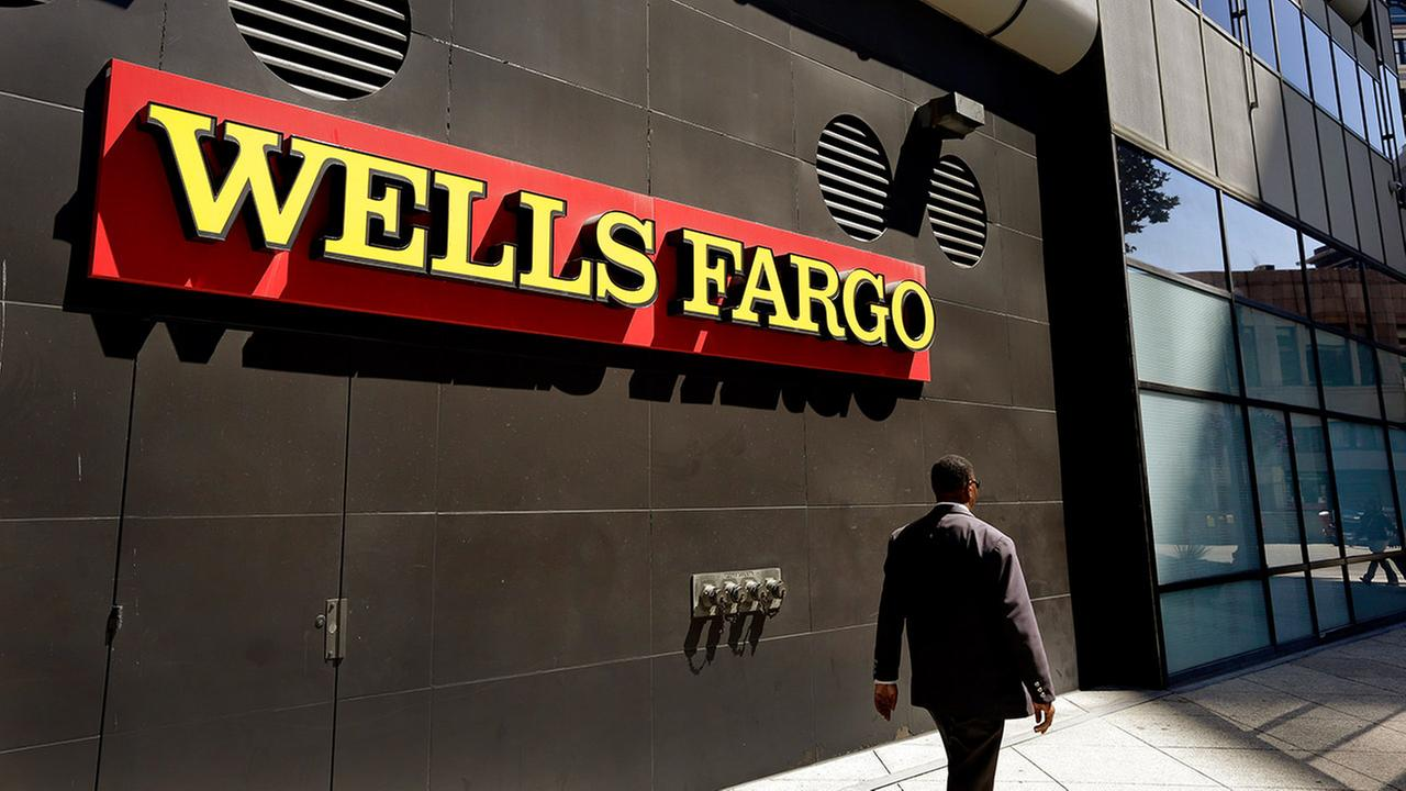 A man passes by a Wells Fargo bank office in Oakland, Calif., in this file photo taken on July 14, 2014.
