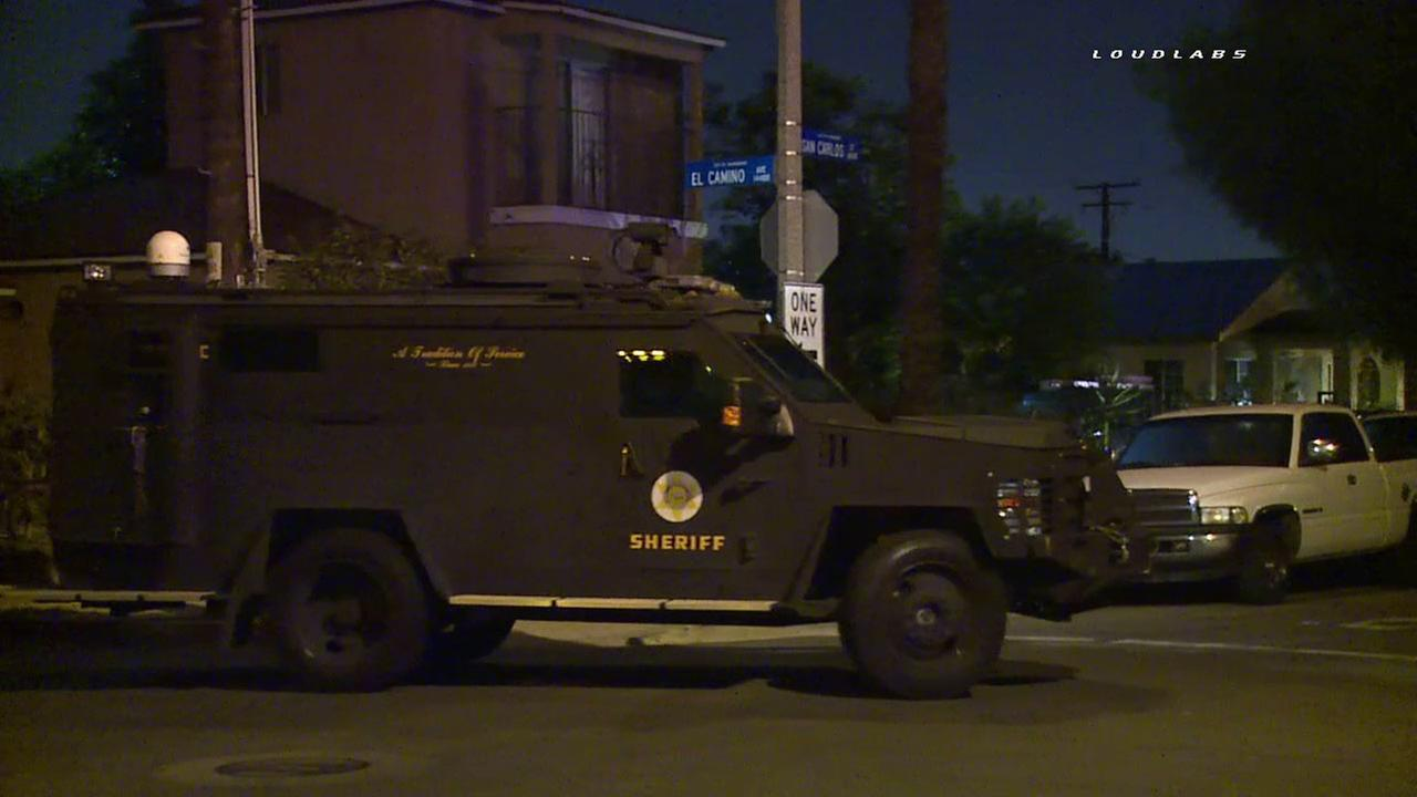 A Los Angeles Sheriffs Department SWAT team responded after an armed man barricaded himself at a home in Paramount on Friday, Sept. 9, 2016.