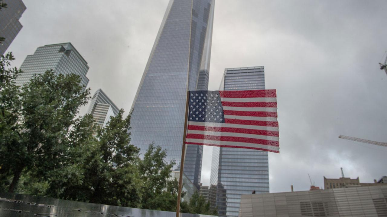In this Sept. 11, 2015 file photo, a flag is placed along the South Pool prior to a ceremony at the World Trade Center site in New York.