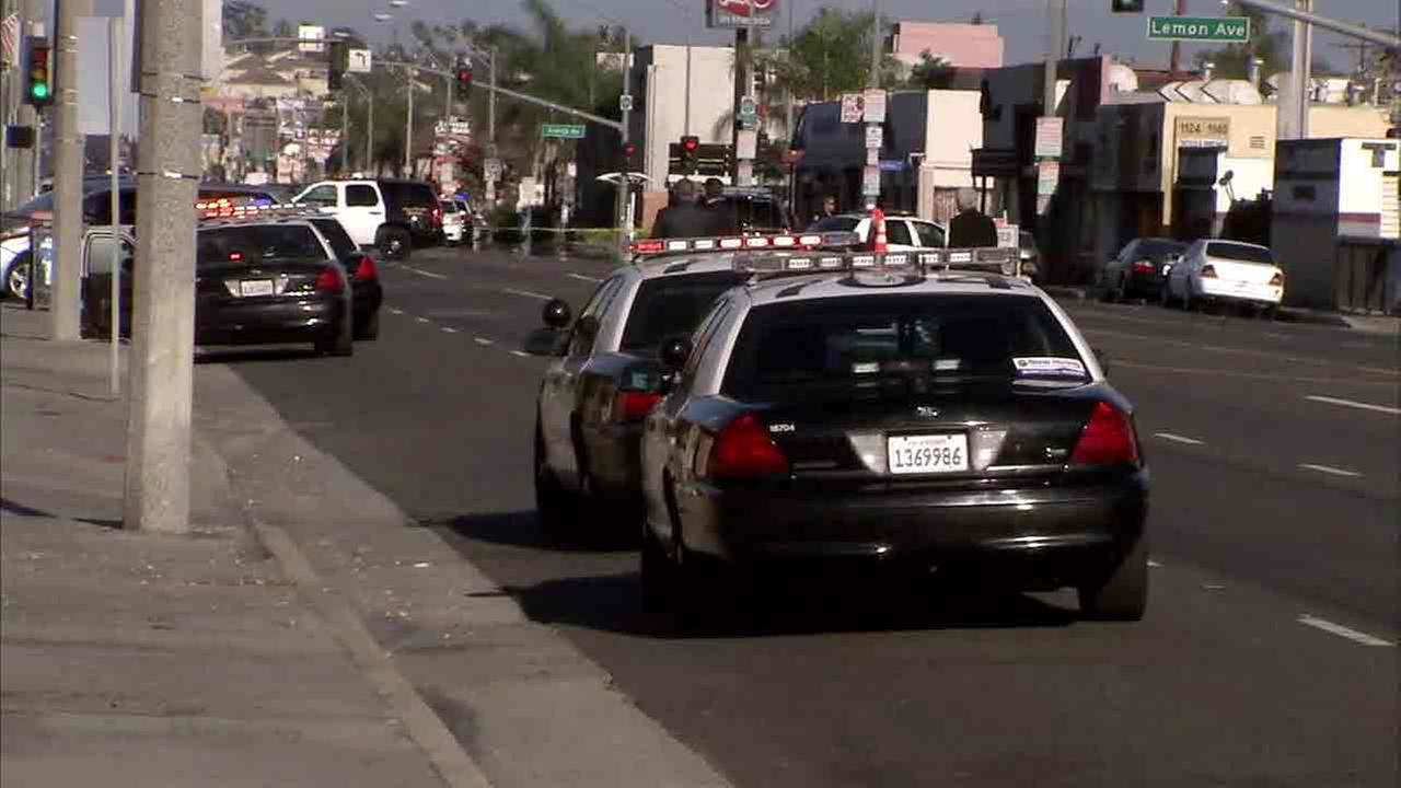 Patrol cars surround the scene of an officer-involved shooting in Long Beach on Sunday, Sept. 11, 2016.