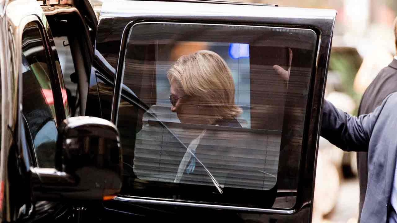 Democratic presidential candidate Hillary Clinton gets into a van as she leaves an apartment building Sunday, Sept. 11, 2016, in New York.