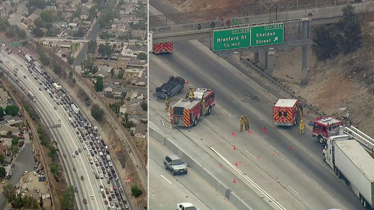 Firefighters responded to a rollover crash on the 5 Freeway in Sun Valley, which shut down lanes and caused a large traffic jam on Monday, Sept. 12, 2016.