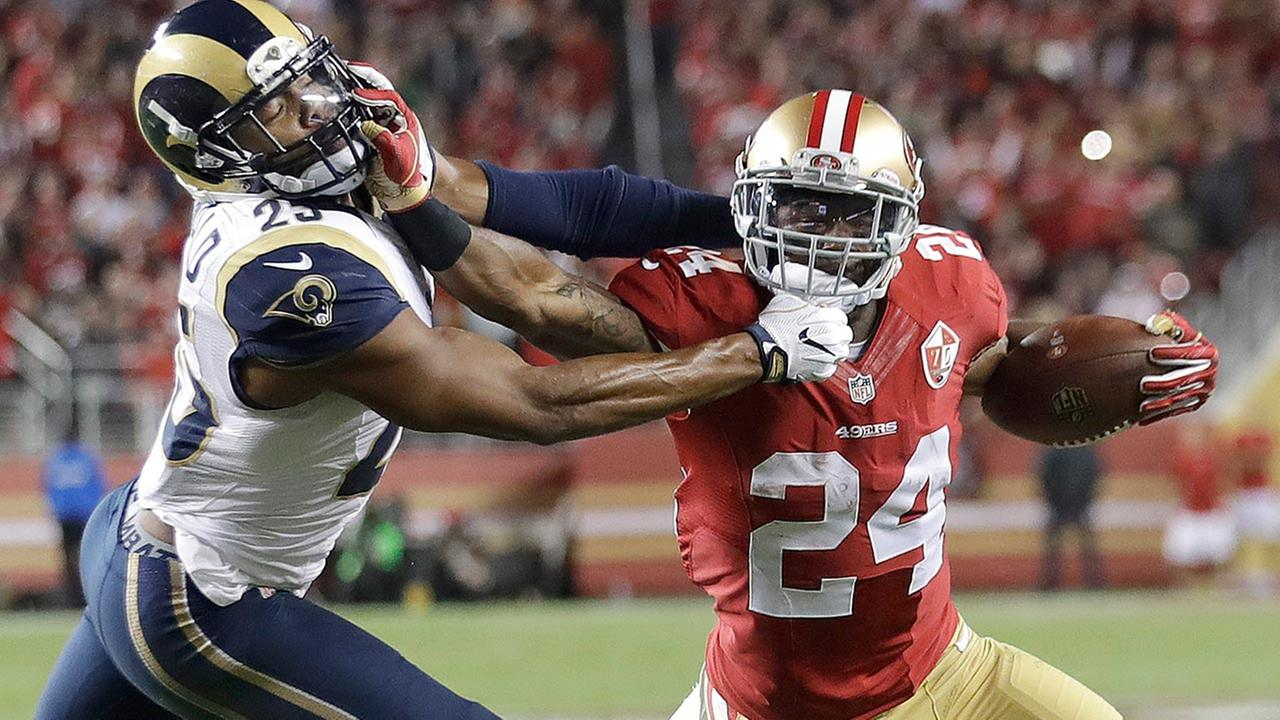 San Francisco 49ers RB Shaun Draughn stiff arms Los Angeles Rams SS T.J. McDonald to score on a touchdown run on Monday, Sept. 12, 2016.