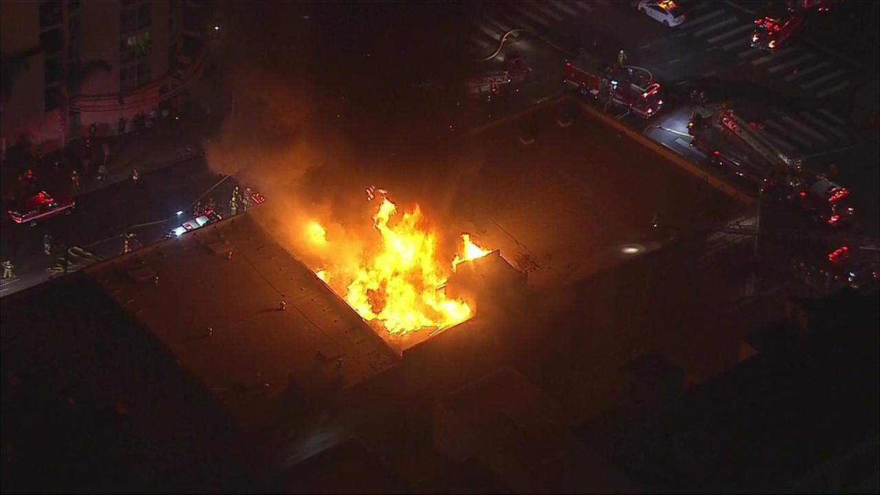 Dramatic flames emanate from a two-story commercial building in the Little Tokyo neighborhood of downtown Los Angels on Monday, Sept. 12, 2016.