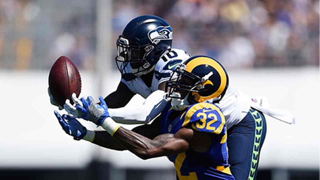 Paul Richardson, left, cant hold on to a pass intended for him as LA Rams cornerback Troy Hill puts pressure on him during a game Sunday, Sept. 18, 2016, in Los Angeles.