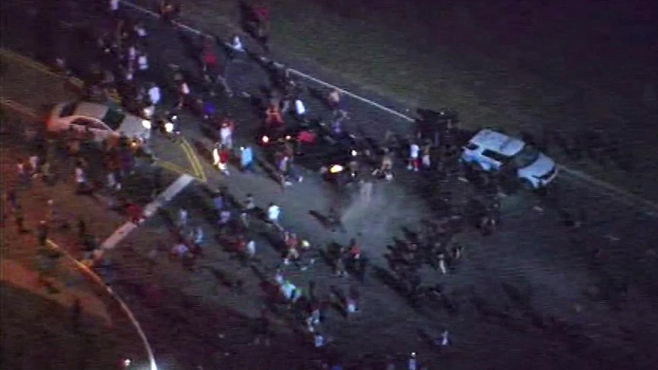 Protesters and police clash in Charlotte, North Carolina, after officials said officers shot and killed an armed man on Tuesday, Sept. 20, 2016.