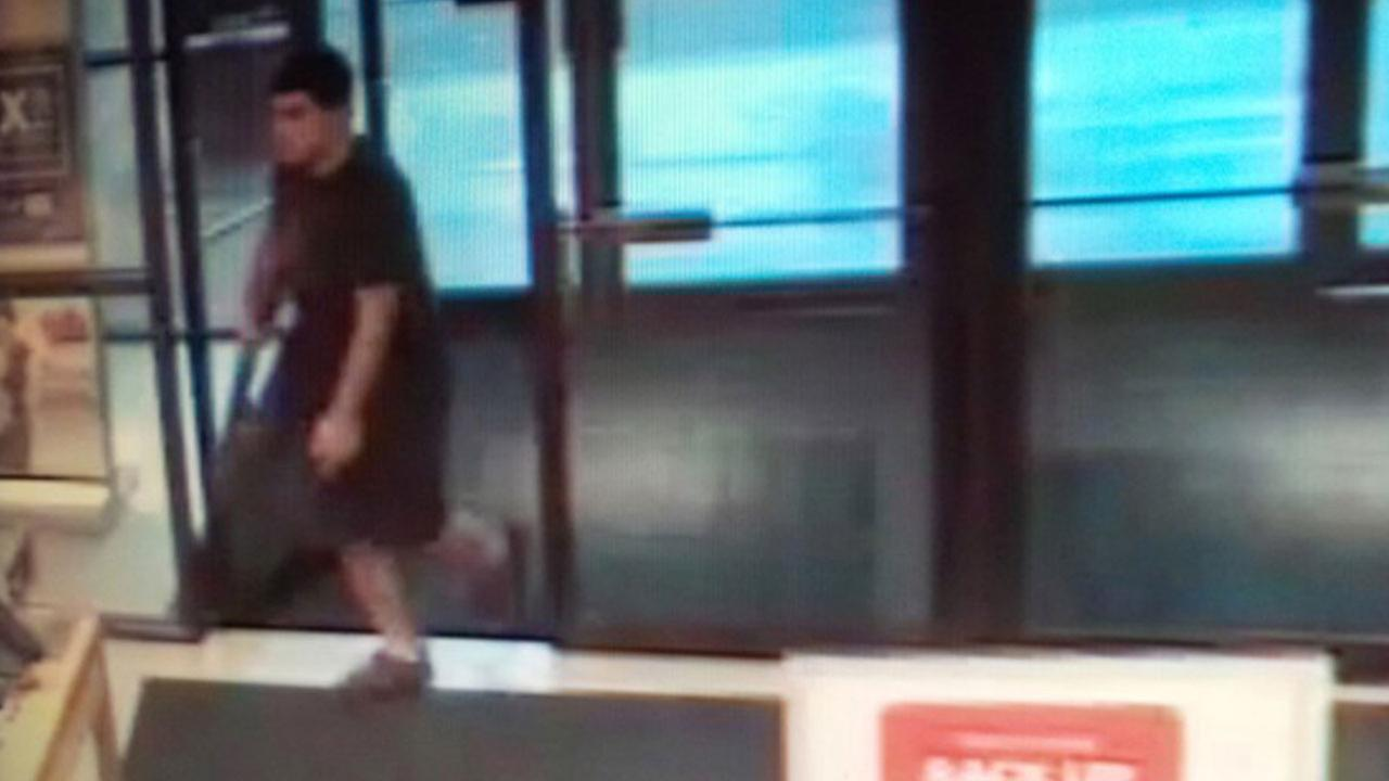 This Friday, Sept. 23, 2016 frame from surveillance video provided by the Washington State Patrol shows the suspect in a shooting rampage at the Cascade Mall in Burlington, Wash.