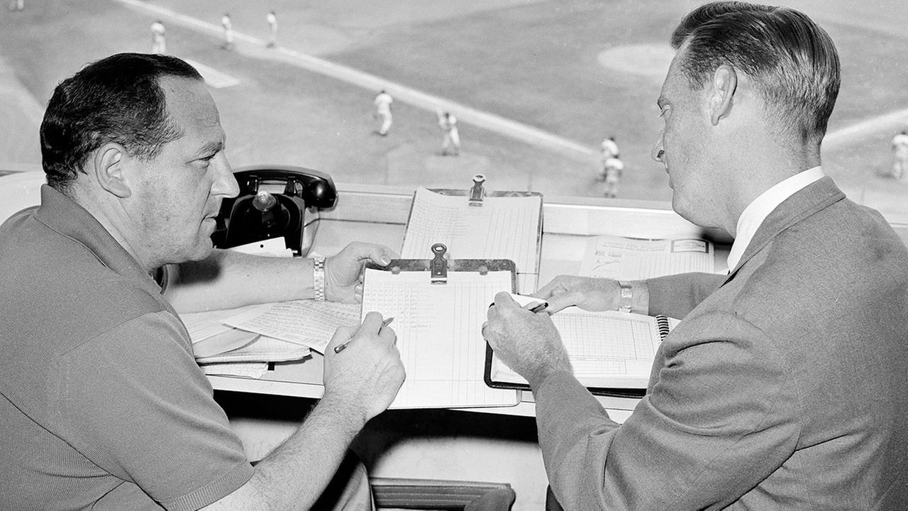 Los Angeles Dodgers statistician Allan Roth, left, and Vin Scully, right, in Los Angeles, Aug. 5, 1963.AP Photo/Harold Filan