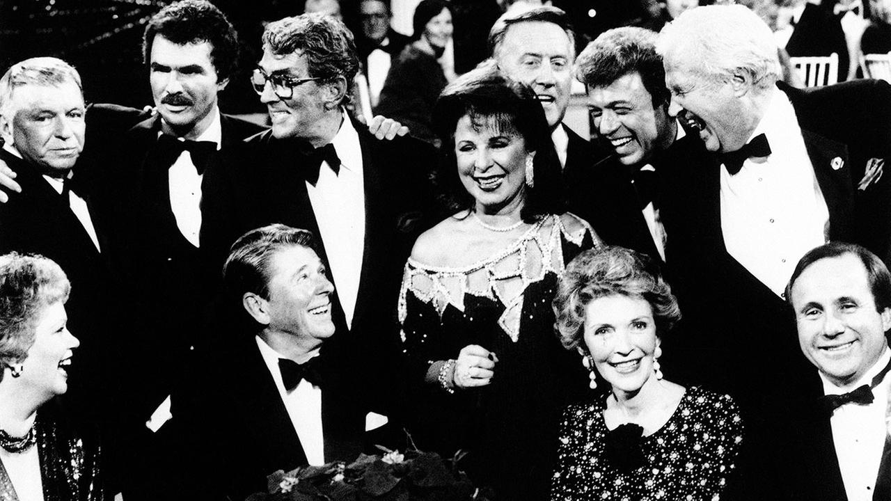Former U.S. President Ronald Reagan and Mrs. Nancy Reagan surrounded by Hollywood friends on Dec. 1, 1985 in Burbank, Calif., including Los Angeles Dodgers broadcaster Vin Scully.AP Photo/Scott Stewart
