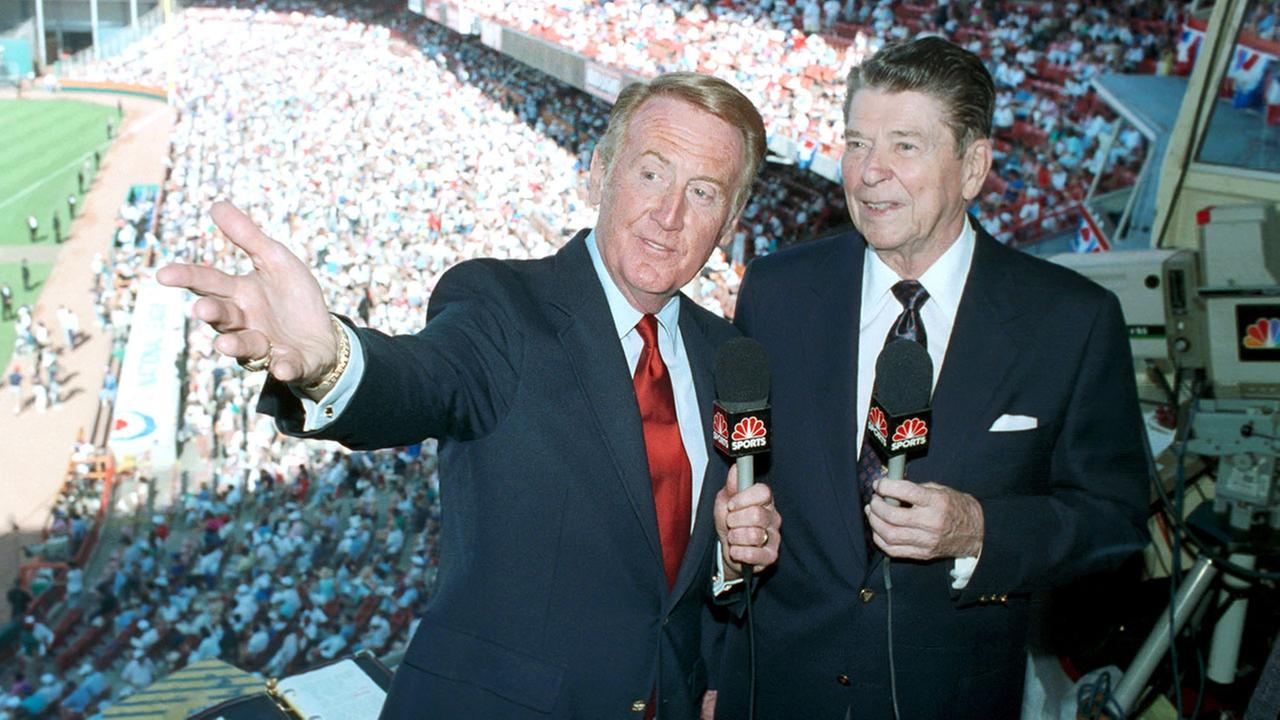 Announcer Vin Scully, left, joins former President Ronald Reagan in the announcers booth at Anaheim Stadium, Anaheim, Calif., during the 60th MLB All-Star Game, July 11, 1989.AP Photo/Jeff Robbins