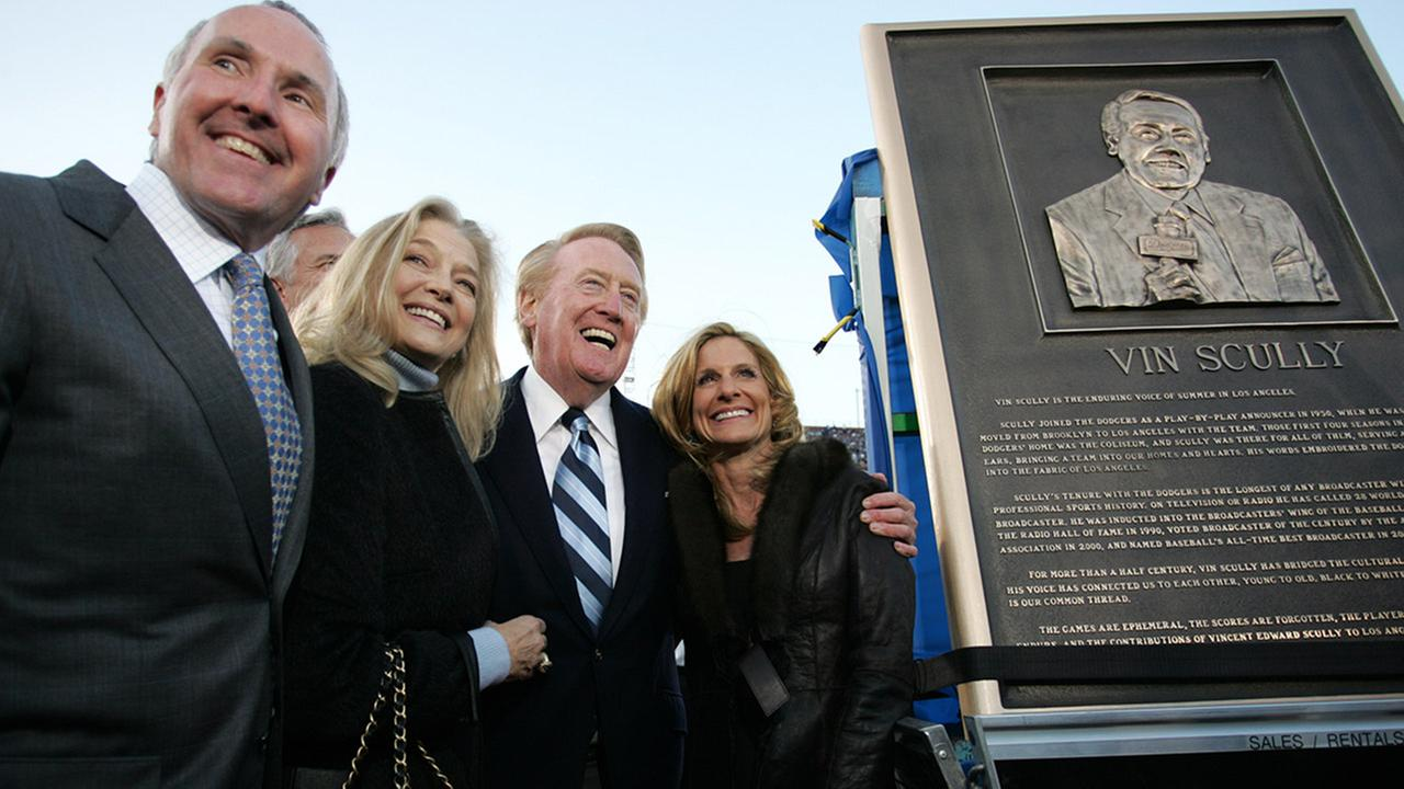 Los Angeles Dodgers owner Frank McCourt, left, wife Jamie, and Vin Scully, second from left, with wife Sandra, pose next to a plaque honoring Scully on Saturday, March 29, 2008.AP Photo/Branimir Kvartuc
