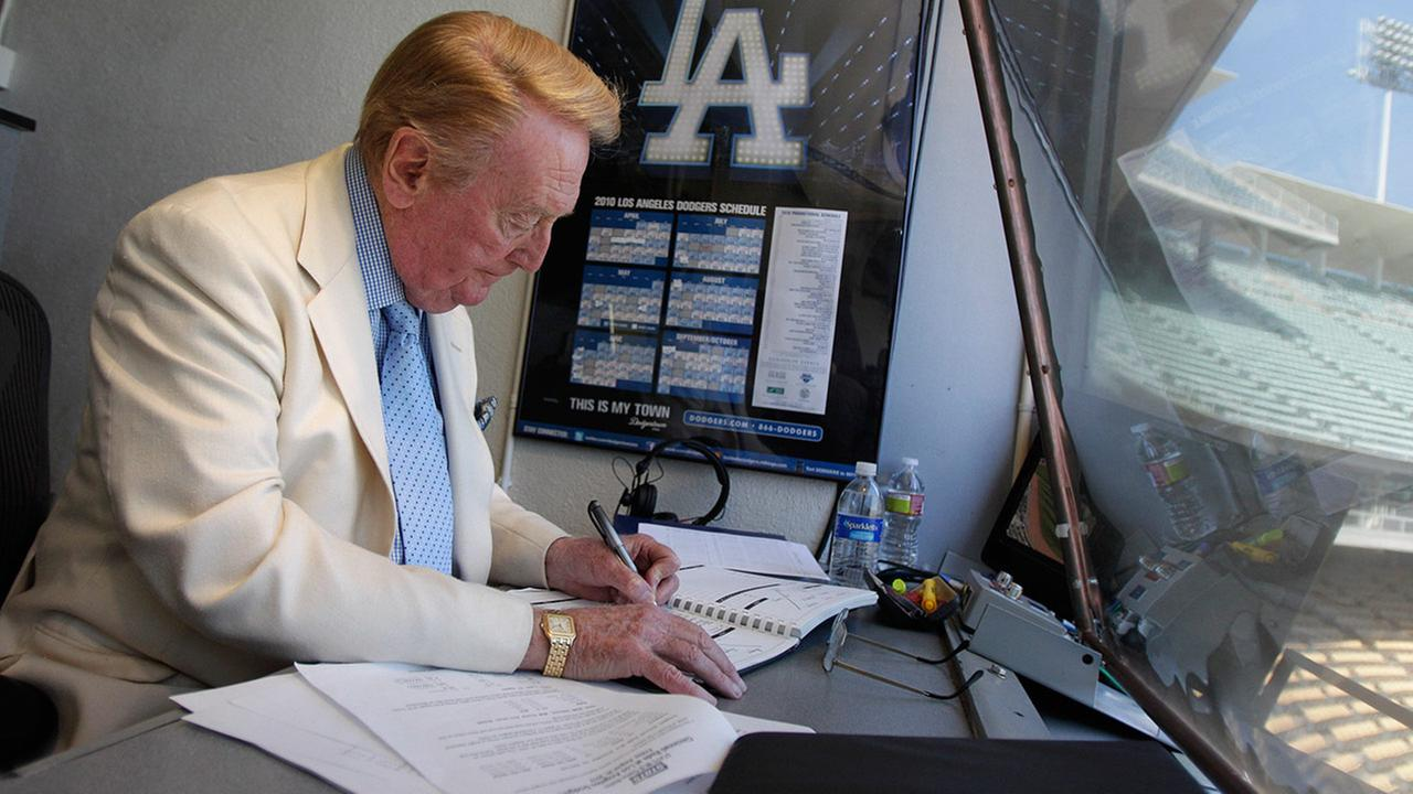 Vin Scully works in his booth at Dodger Stadium in Los Angeles, Sunday, Aug. 22, 2010.AP Photo/Jae C. Hong