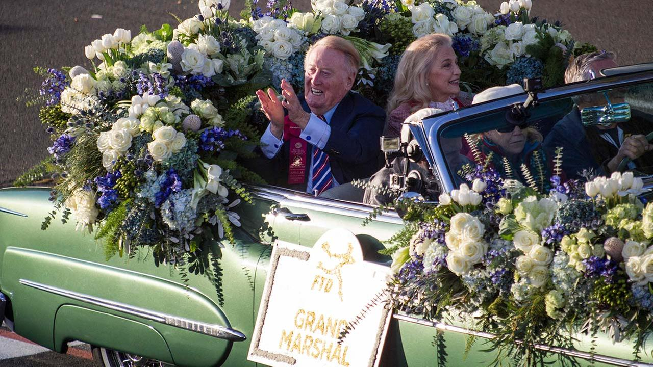 Vin Scully greets other recipients aboard the float moving along Orange Grove Boulevard during the 125th Tournament of Roses Parade in Pasadena, Calif., Wednesday, Jan. 1, 2014.AP Photo/Ringo H.W. Chiu