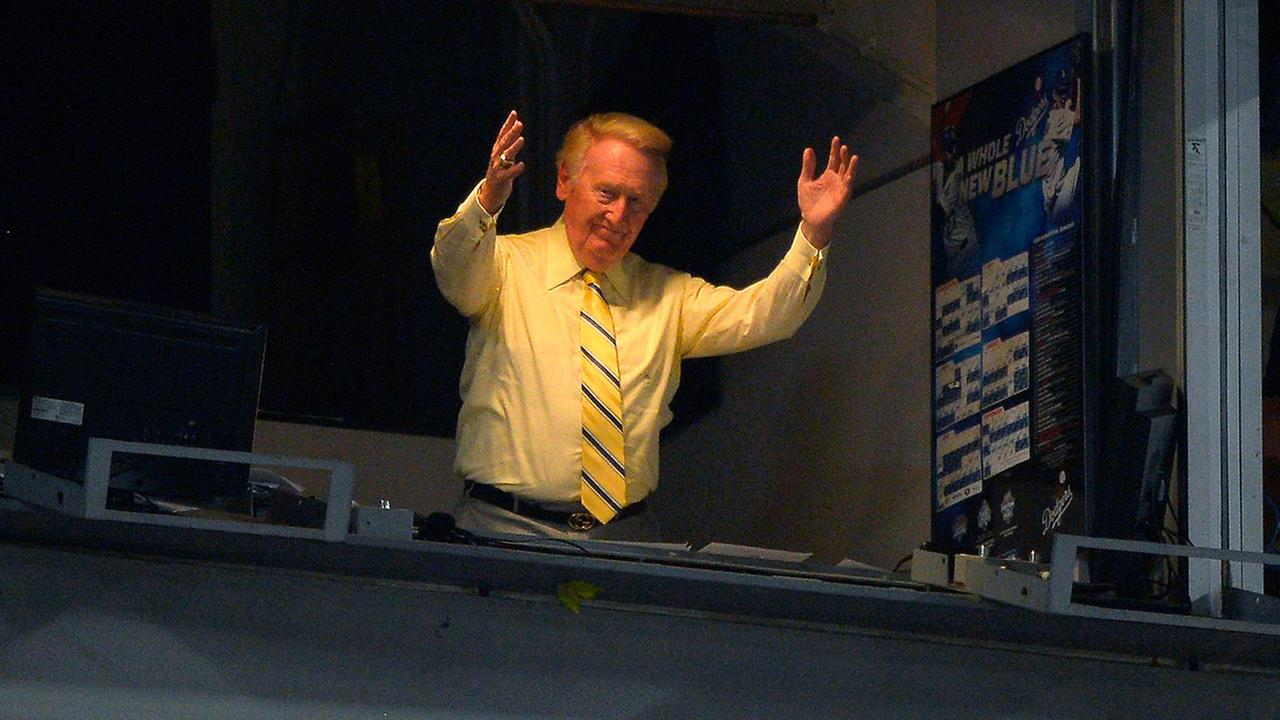 Vin Scully acknowledges fans during Vin Scully bobble head night during a baseball game, Thursday, July 25, 2013, in Los Angeles.AP Photo/Mark J. Terrill