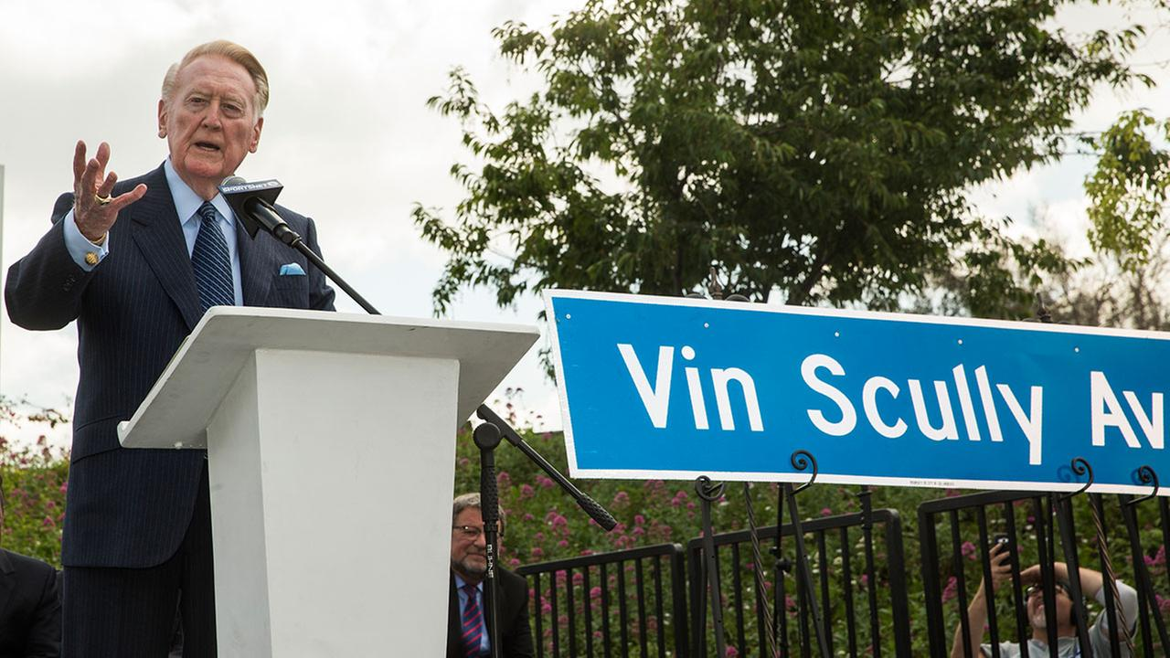 Dodger legend Vin Scully speaks at a dedication ceremony unveiling a street sign of his namesake at the entrance to Dodger Stadium in Los Angeles on Monday, April 11, 2016.AP Photo/Damian Dovarganes