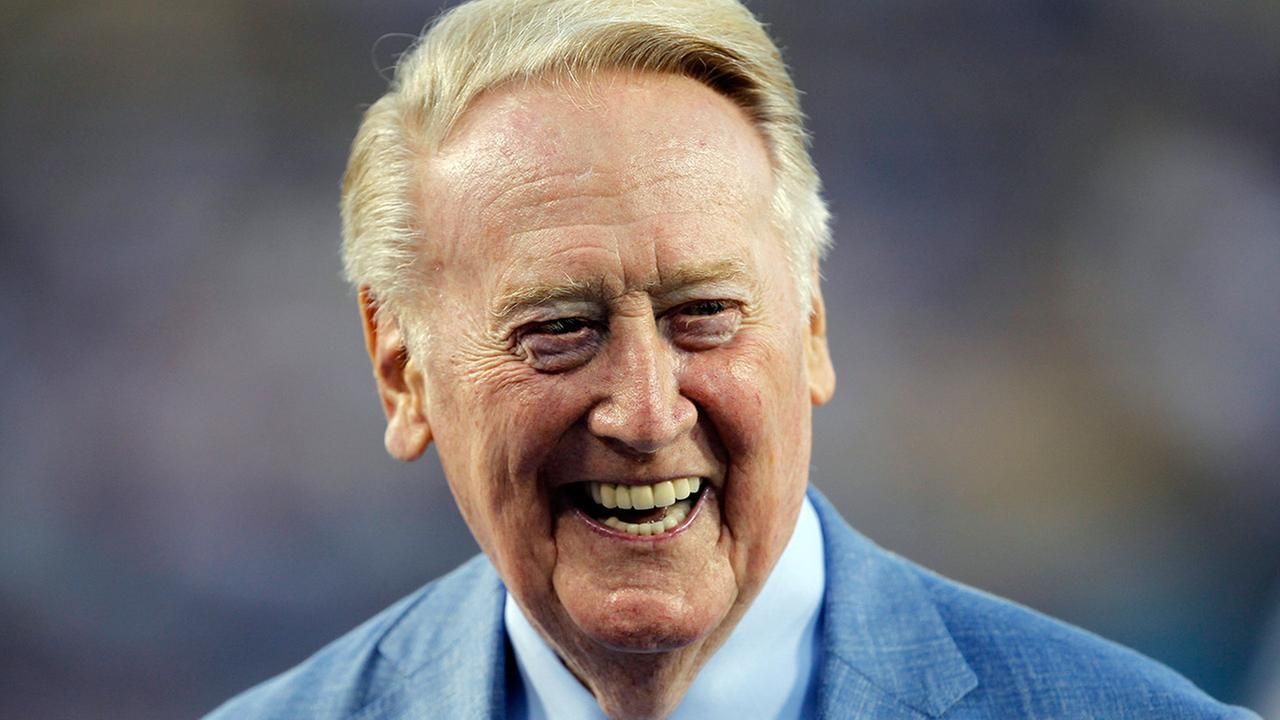 Vin Scully is honored before a baseball game against the Arizona Diamondbacks in Los Angeles, Wednesday, Sept. 23, 2015.