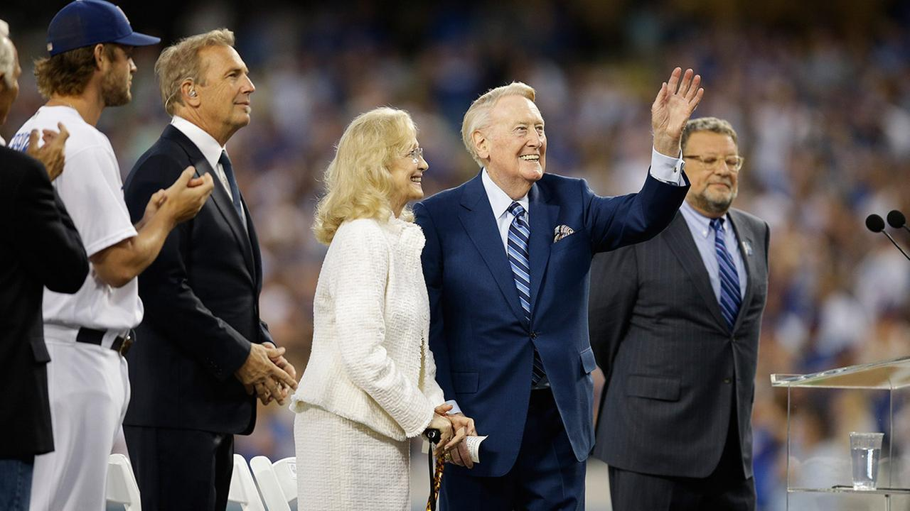 Vin Scully and wife, Sandi, acknowledge the fans during Vin Scully Appreciation Day on Friday, Sept. 23, 2016, in Los Angeles.AP Photo/Jae C. Hong