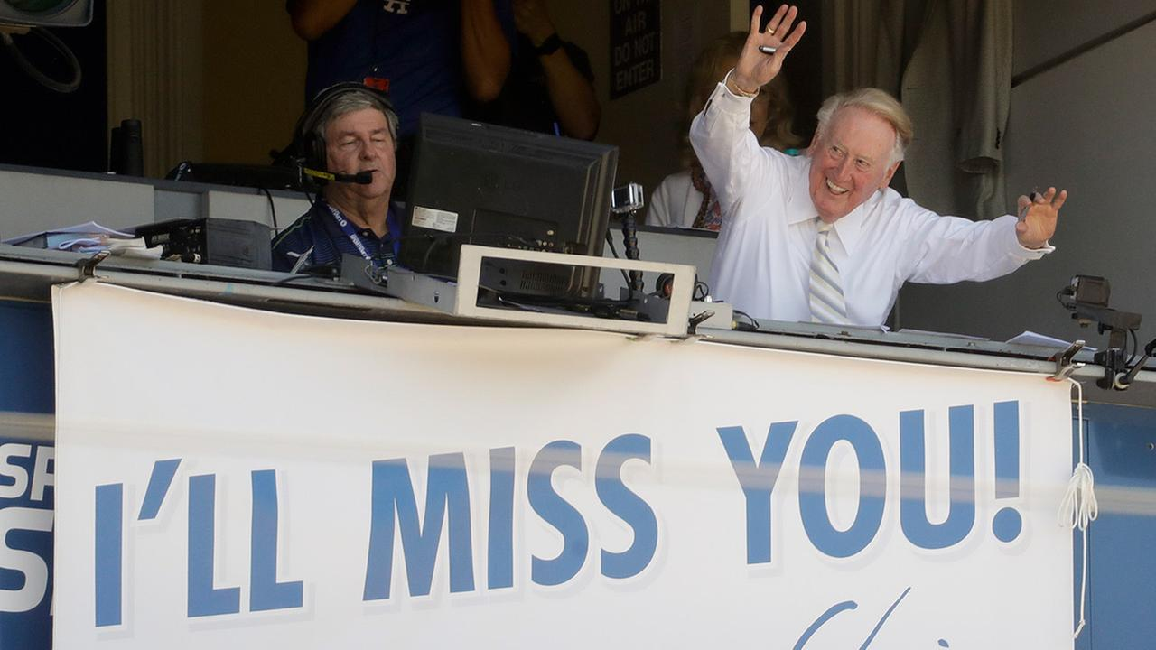 Vin Scully waves to the fans at Dodger Stadium on Sunday, Sept. 25, 2016. The game would be his final home game in Los Angeles before his retirement.