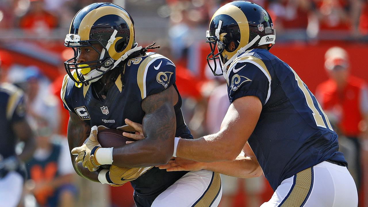 Los Angeles Rams running back Todd Gurley (30) takes the hand off during an NFL football game against the Tampa Bay Buccaneers Sunday, Sept. 25, 2016, in Tampa, Fla.