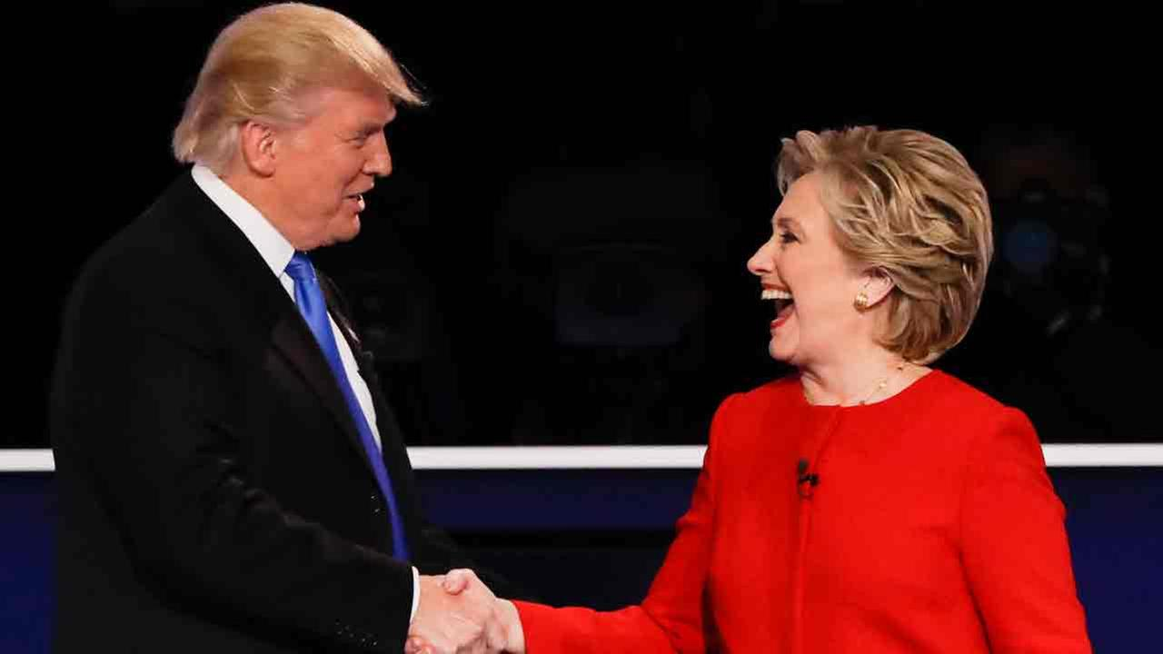 Republican presidential nominee Donald Trump shakes hands with Democratic presidential nominee Hillary Clinton after the presidential debate in Hempstead, N.Y., on Sept. 26, 2016.