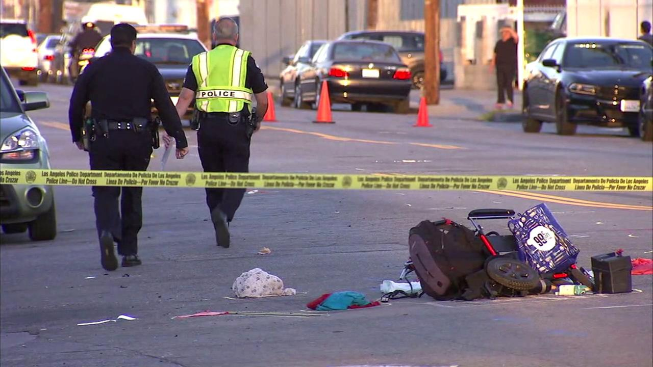 Los Angeles police investigators are seen at a crash site in North Hollywood where a woman in a wheelchair was fatally struck.