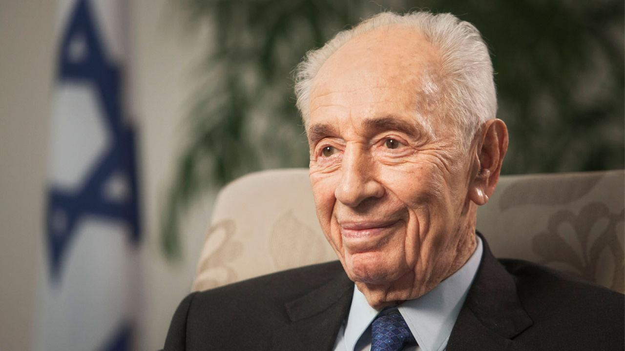 In this Nov. 2, 2015 file photo, former Israeli President Shimon Peres speaks during an interview with The Associated Press in Jerusalem.