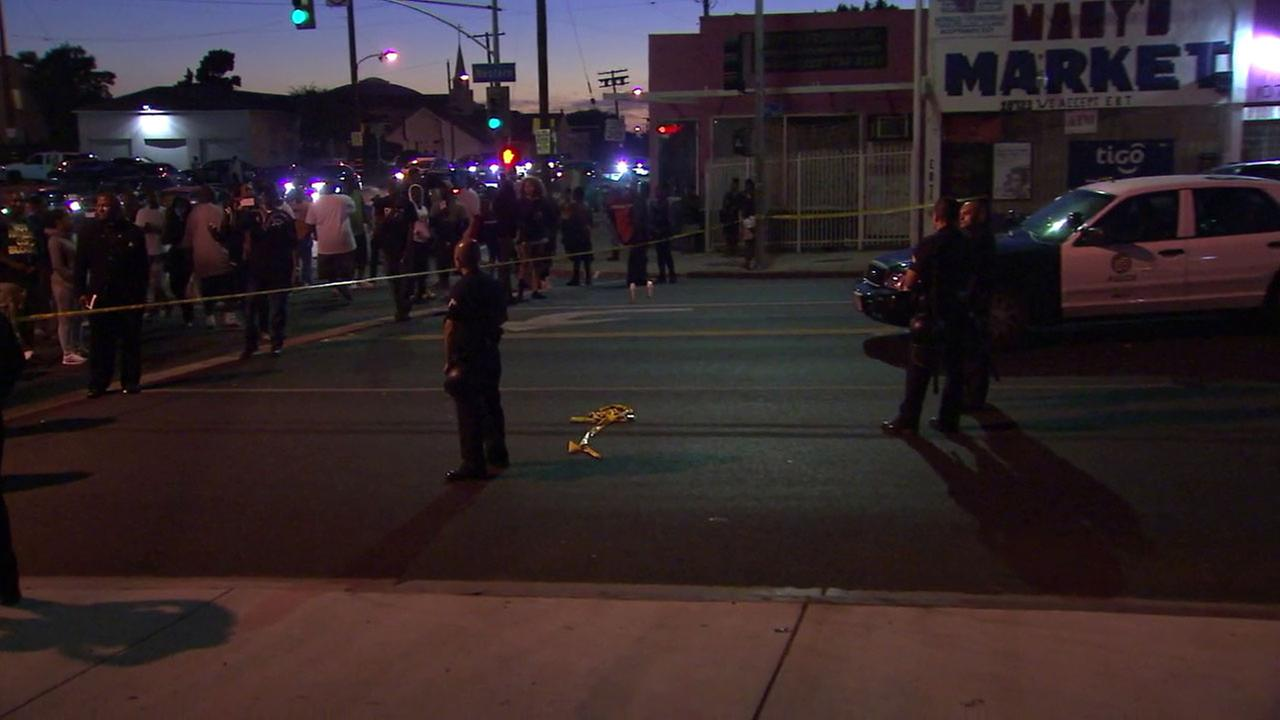 Los Angeles officers and demonstrators are separated by crime tape as tensions mount following a fatal police shooting in South Los Angeles on Saturday, Sept. 30, 2016.