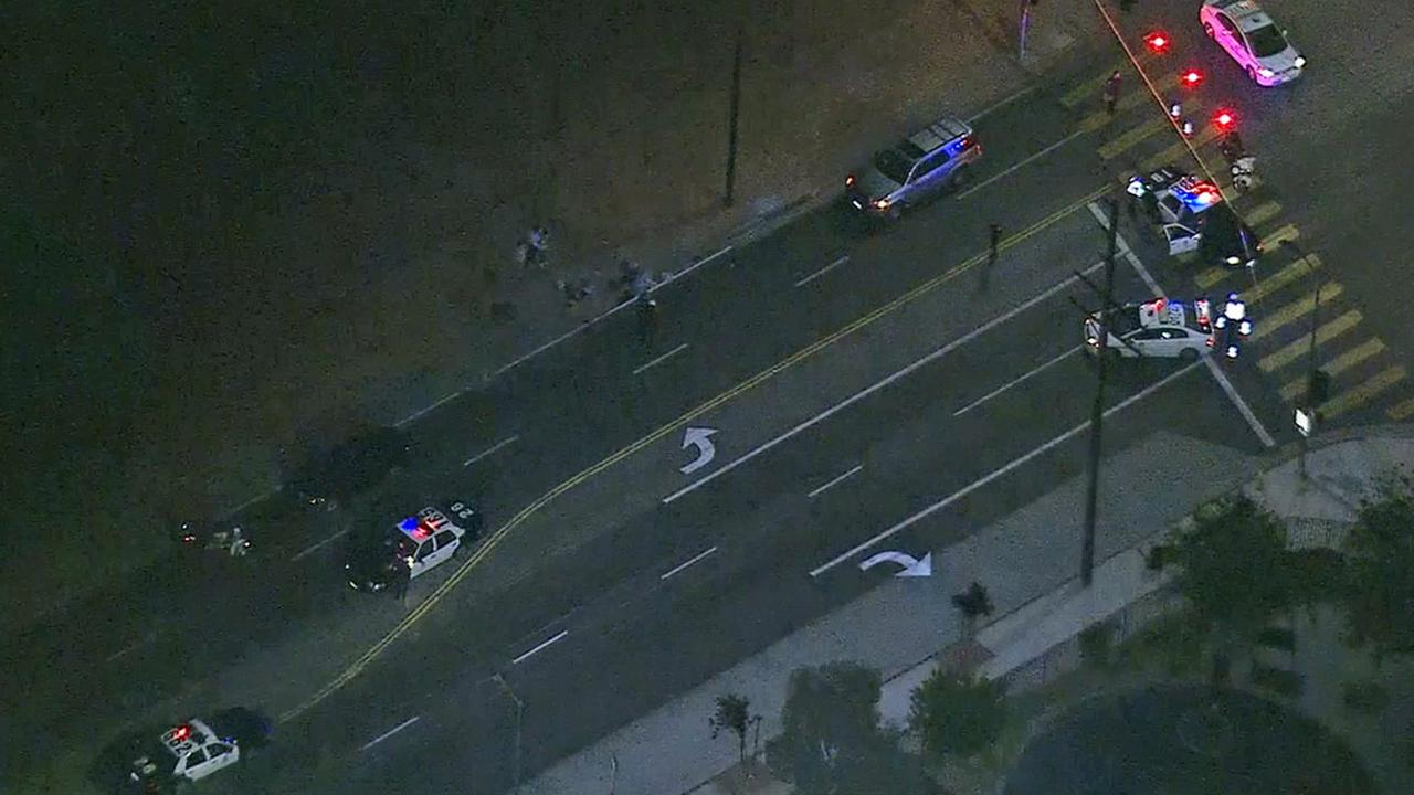 LAPD officers investigate a hit-and-run at Laurel Canyon Boulevard and Fox Street on Wednesday, July 2, 2014.