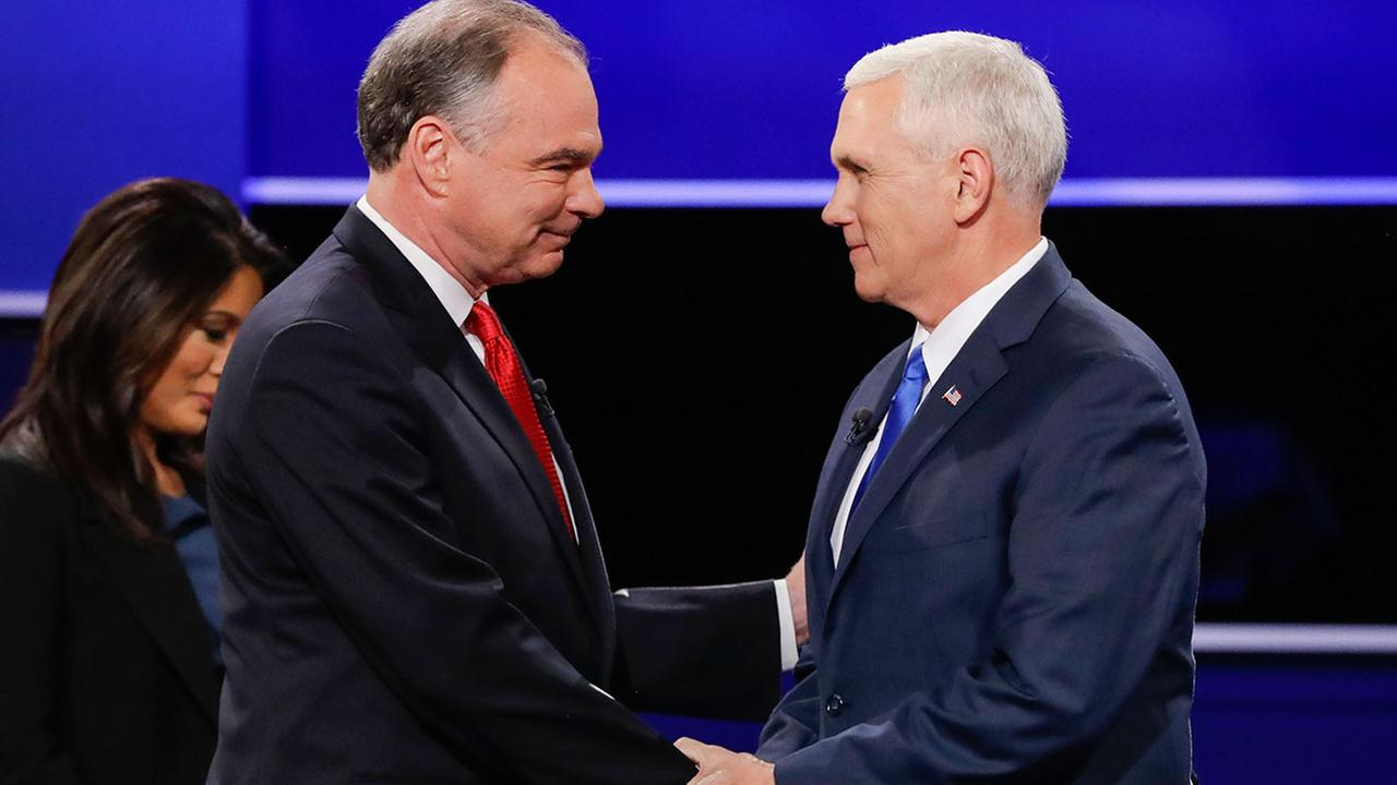Virginia Sen. Tim Kaine (left) and Indiana Gov. Mike Pence (right) shake hands at their vice-presidential debate on Tuesday, Oct. 4, 2016 in Farmville, Va.