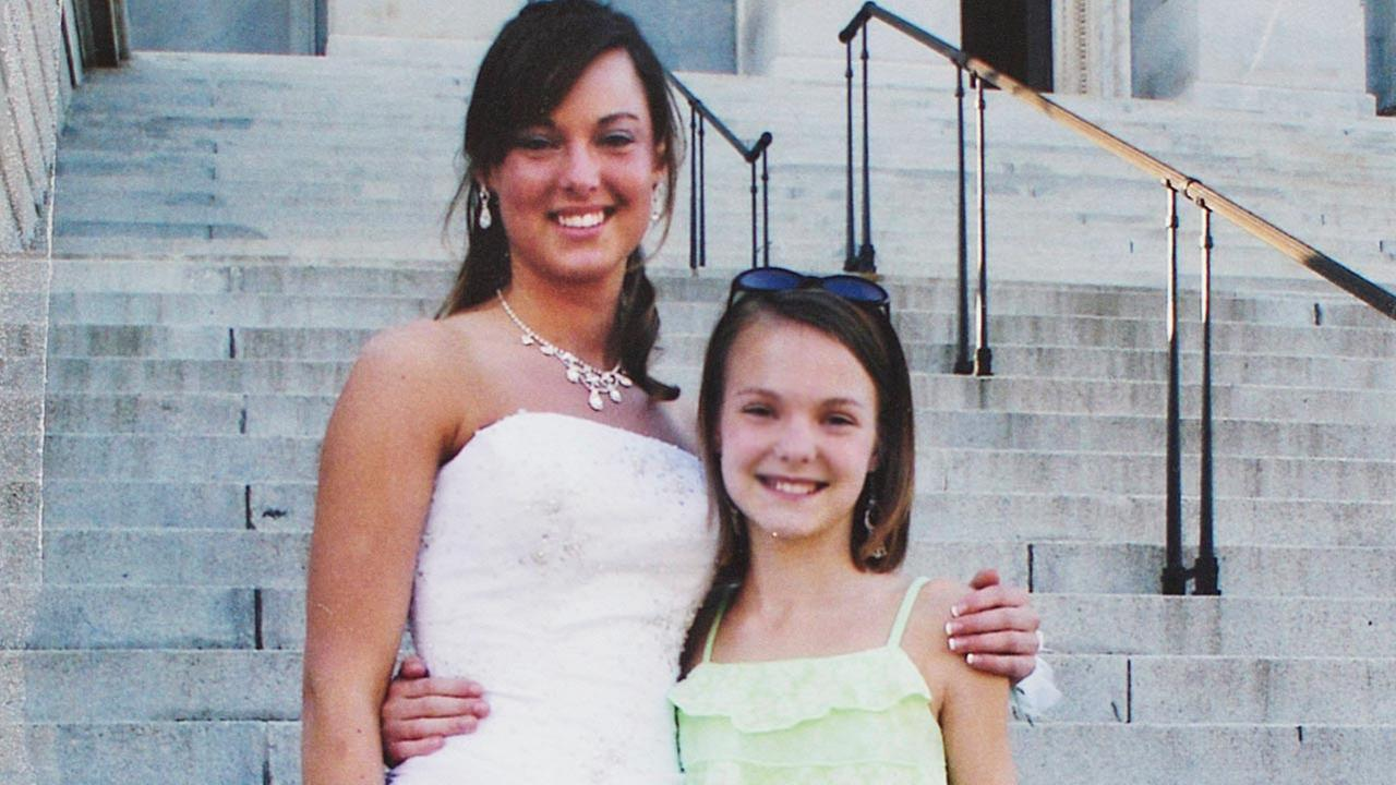 2005 file photo provided by the Jones family shows Sarah Jones, left, on the day of her high school prom with her sister.