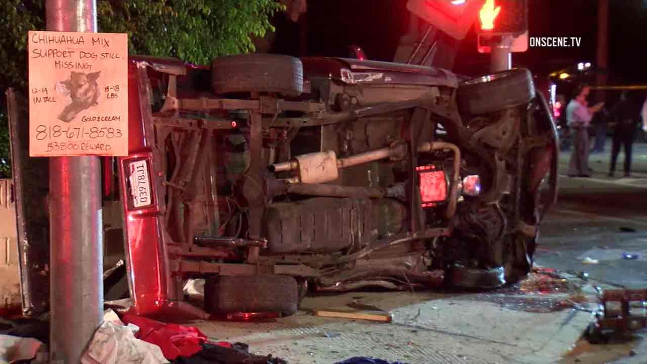 A truck is rolled over in Chatsworth following a deadly crash that that killed two late Friday, Oct. 7, 2016.