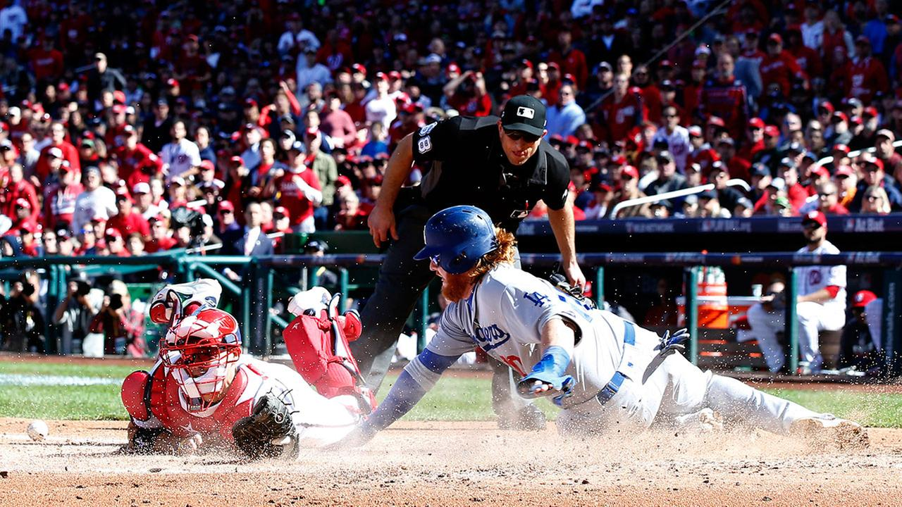 Dodgers Justin Turner is safe at home when Nationals catcher Jose Lobaton cant hang onto the ball in Game 2 of the NLDS on Sunday, Oct. 9, 2016 in Washington.