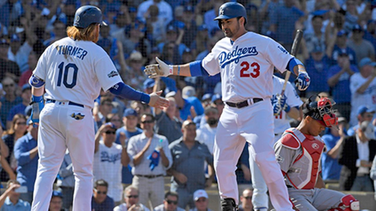 Dodger Adrian Gonzalez (23) celebrates with Justin Turner after hitting a two-run homer as Washington Nationals catcher Pedro Severino looks away in Game 4 of the NLDS.