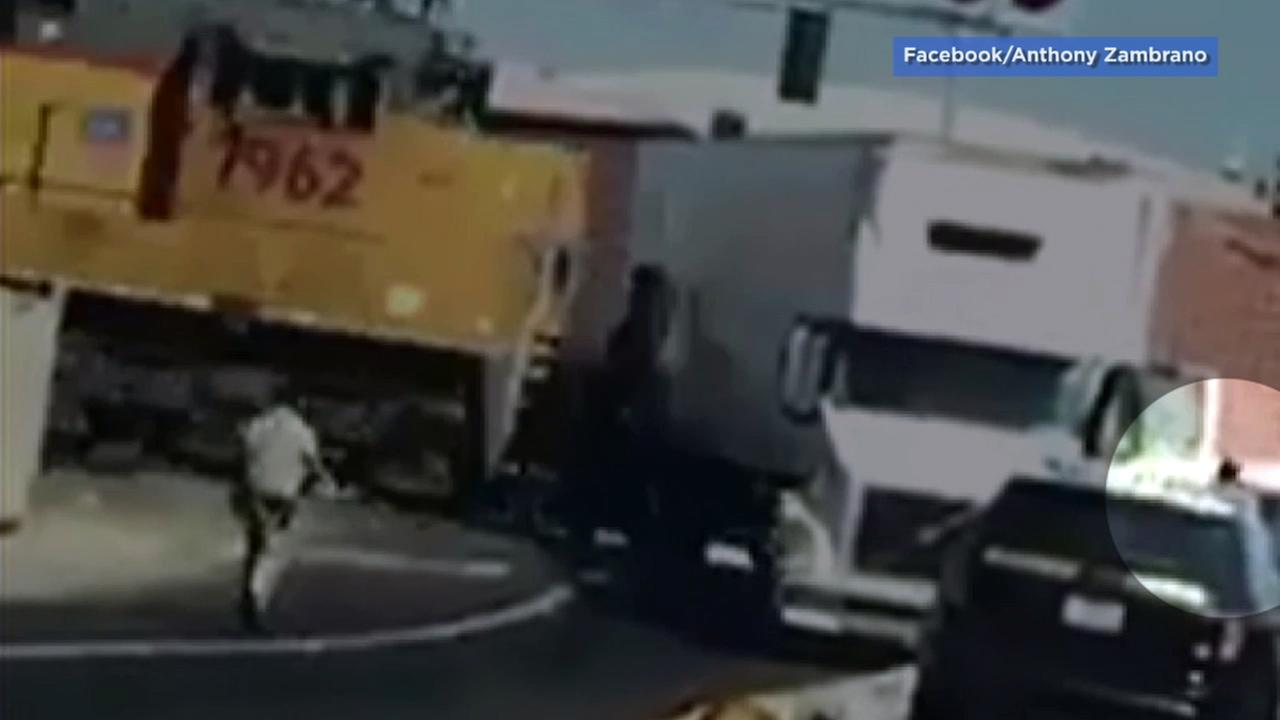 Video captured a driver fleeing from a stalled semi-truck just seconds before a train smashed through it in Atwater, California, on Tuesday, Oct. 11, 2016.